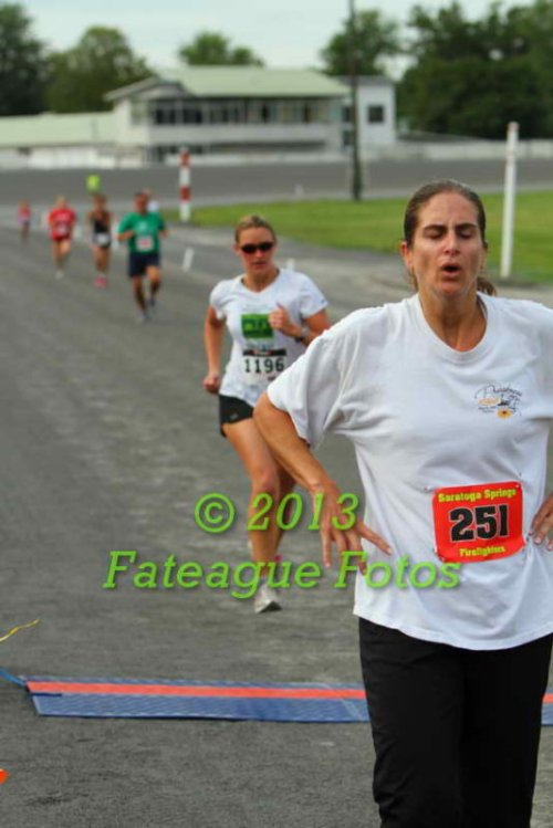 Me running the Monday Night Mile. No, I have not been working on my form. Why do you ask? Photo credit: Brian Teague of Fateague Fotos.