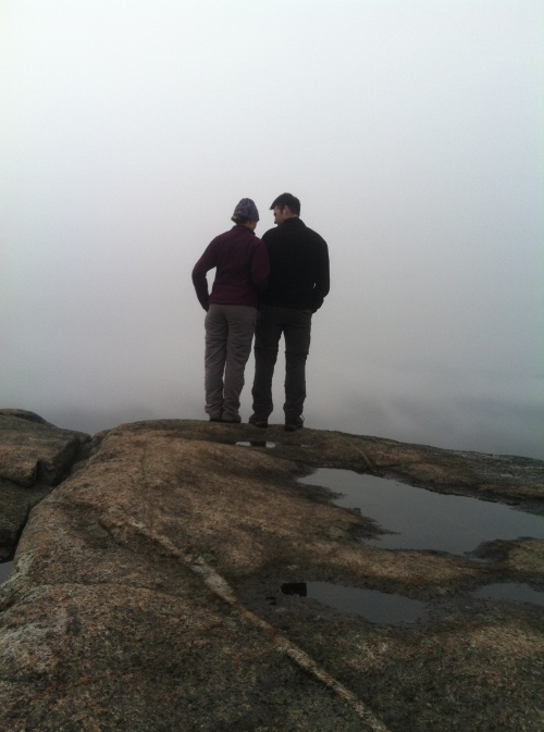 Pondering the view from the summit of Cascade Mountain.