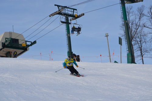 My relay teammate shredding the gnar under bluebird skies.